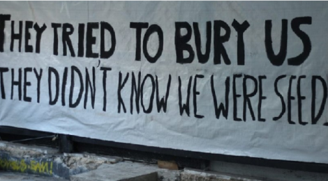 "Banner with slogan ""The tried to Bury us. They didn't know we were seeds."" In solidarity with Exarchia Athens Eviction August 2019"